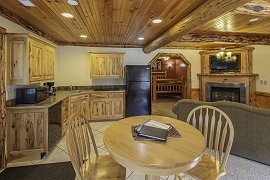Adorned With Log Ceilings Beams Wainscoting And Cabin Furniture This Suite Will Make You Feel Like Are In A Built For Two